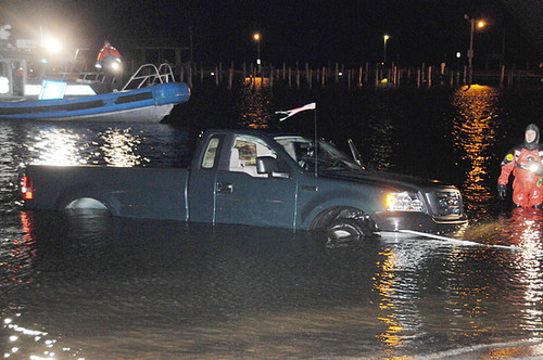 Emergency crews haul a pickup truck out of the water near Shore Front Park and Smith Street after a driver slammed through a dock and landed in Patchogue Bay. (Photo by James Carbone / December 21, 2008)